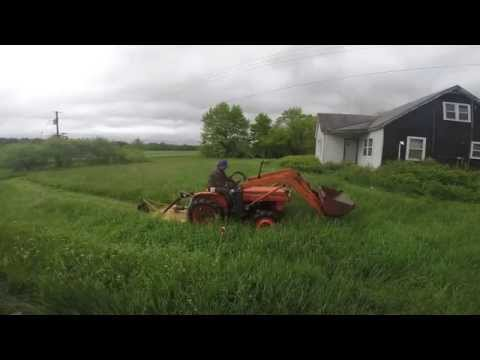 kubota LT185 4 wheel drive with a brush hog