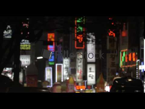 Advertising banners and car traffic in night Seoul, South Korea