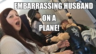 EMBARRASSING HUSBAND PLAYS WITH WWE TOYS on AIRPLANE FLIGHT!