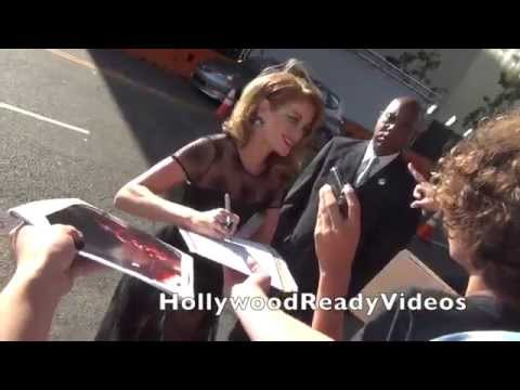 Erica Piccininni signs autographs for  arriving at the Jersey Boys premiere in LA