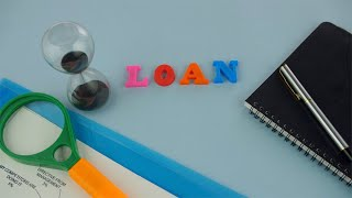 "Closeup shot of the word ""Loan"" composed with colorful letters - microfinance concept"