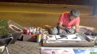 Aerosol painter Artist creates two images in five minutes Piazza Navona Rome HD