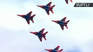 Russian aerobatic teams perform stunts on Victory Day