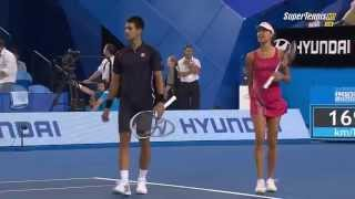 Ana Ivanovic throwing a ball at Novak Djokovic to stop him dancing (Funny)