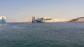 New Suez Canal: a scene in drilling and dredging and navigation through the Suez Canal