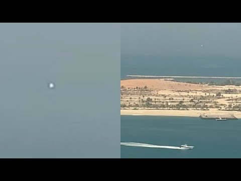 White Spherical UFO Captured Hovering over Abu Dhabi in United Arab Emirates