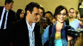 Joaquin Phoenix signing autographs for fans after he tapes a talk show in hollywood