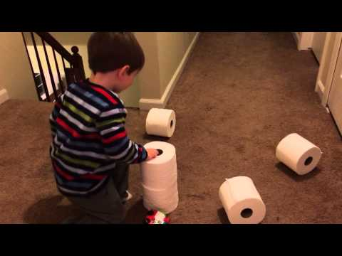 Aaron 25 months old making toilet paper tower