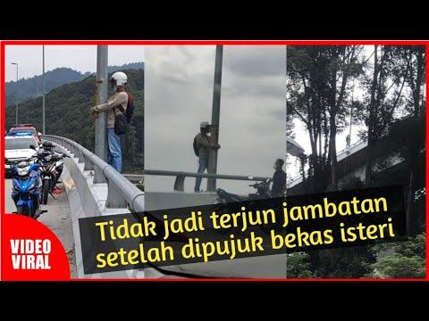 Download Seorang lelaki mengambil risiko untuk terjun jambatan bagi memujuk bekas isteri untuk rujuk semula