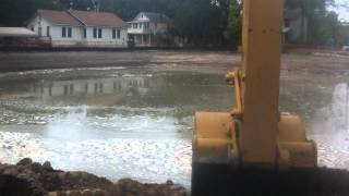 Cab view Cat 336E digging pond