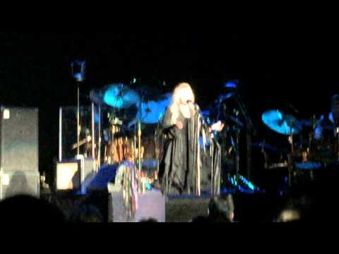Fleetwood Mac Atlanta 2014 Christine and John McVie being friendly while Stevie Nicks is talking .