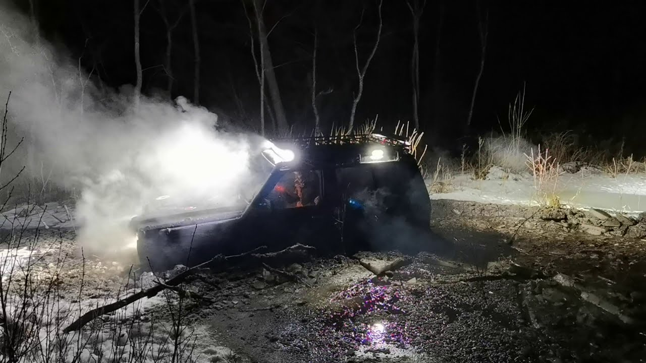 Extreme offroad: Getting the Nissan Patrol out of a deep mud hole, full of ice