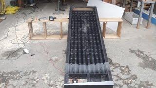 Chauffage d'appoint - Panneau solaire thermique, chauffage fait avec des canettes de coca N°1