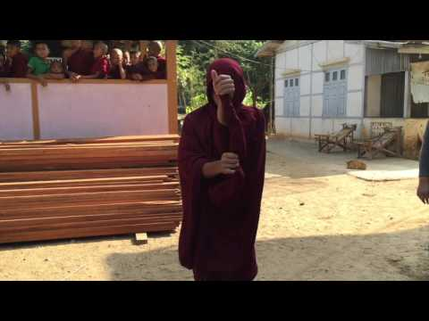 Monk Wrapping His Robe For Alms Collecting In Myanmar | SmarterTravel