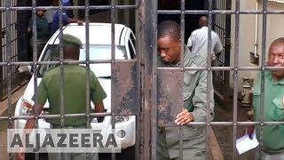 Zimbabwe detains former finance minister on corruption