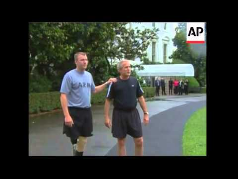 President jogs with soldier who lost legs in Iraq