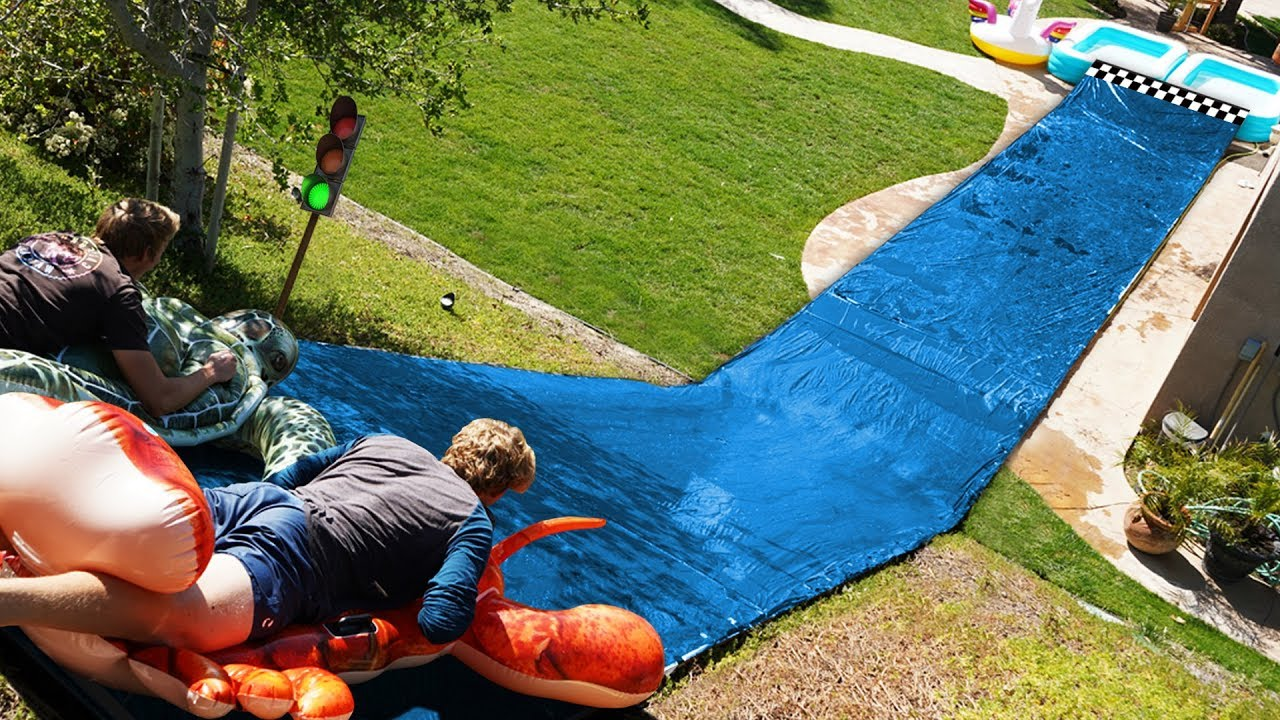 We built a Water Slide Race Track in our Backyard!! - YouTube