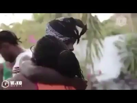 Popcaan hugs his mother after  release from Antigua jail. ... (mother crying)