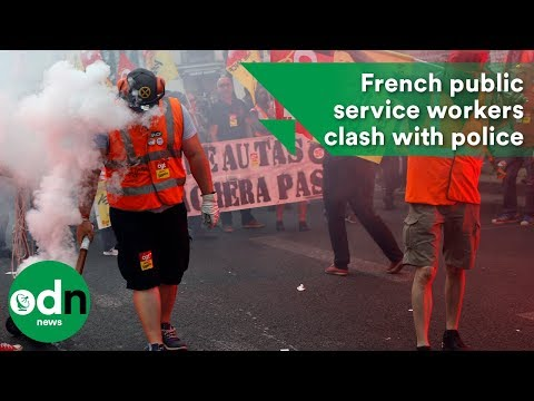 French public service workers clash with police