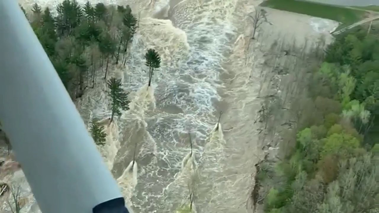 Pilot captures aerial footage of roaring water as Edenville Dam ...