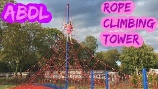 ABDL climbing in rope climbingtower at the playground