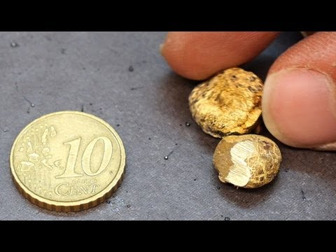 Melting A 10 Cent Euro Coin. Money Transformed Into Nuggets (Tokens).