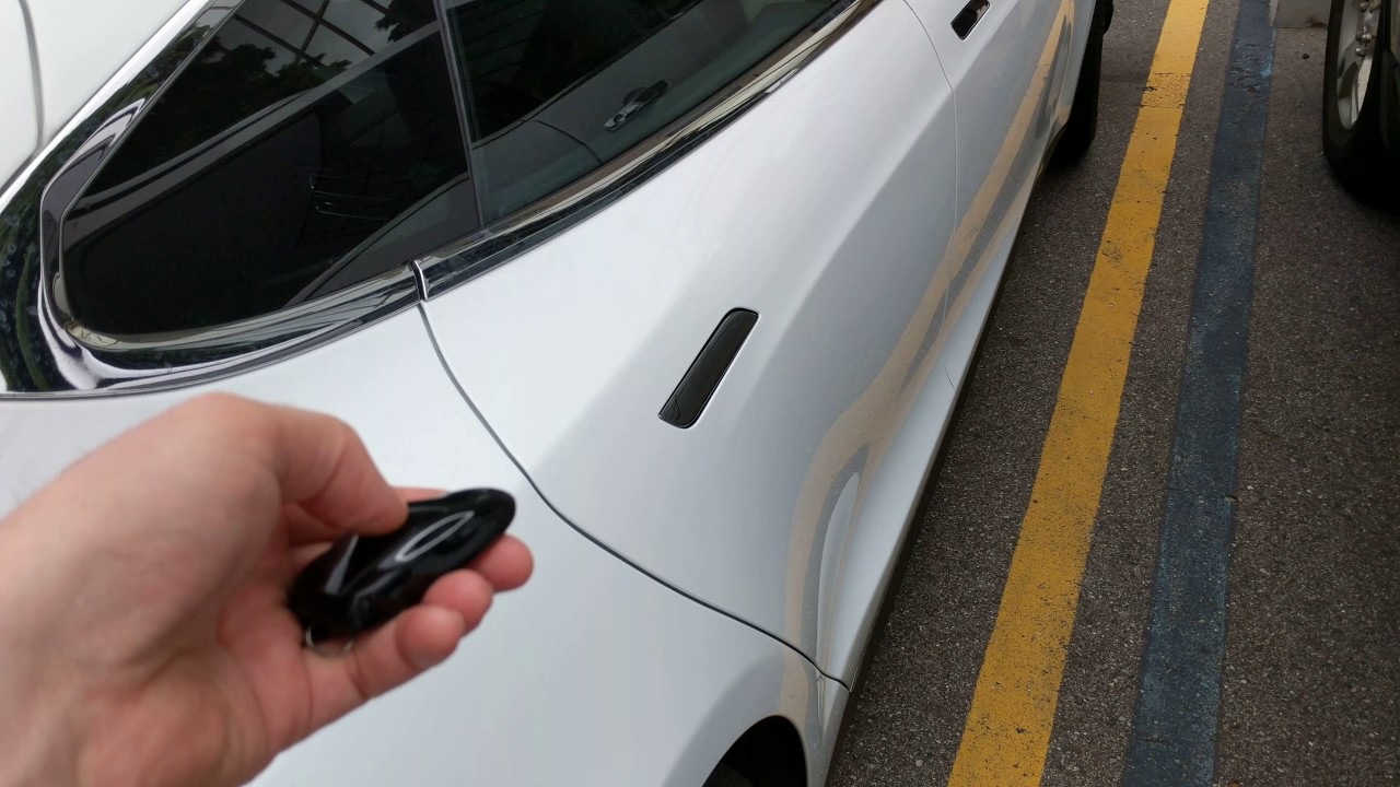 Tesla door opens itself & Tesla door opens itself - YouTube