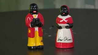 Mardi Gras parade-goers given blackface figurines