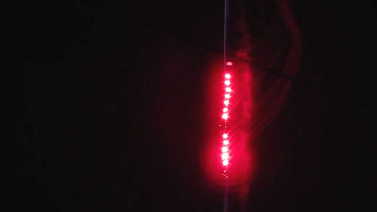 My parachute flare rocket with a long red chain of flares ...