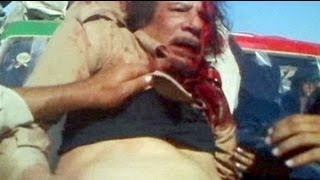 Repeat youtube video Human Rights Watch põe em causa versão oficial da morte de Kadhafi e denuncia execuções...