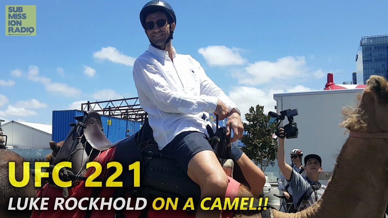 Luke Rockhold Arrives ON A CAMEL to UFC 221 Open Workouts!! Submission Radio