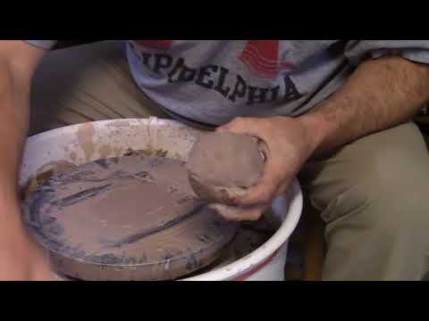 Centering clay on the wheel.  Quick and easy.