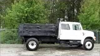 Sold! International 4900 S/A 5.5 Yard Dump Truck Crew Cab DT466 bidadoo.com