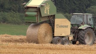Tractor at work! Deutz Agrotron working with a hay baler on the field
