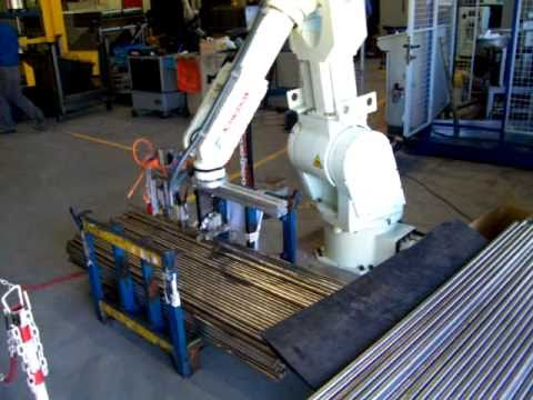Kawasaki Robot feeding steel bars or  tubes  from a container using a laser meter.