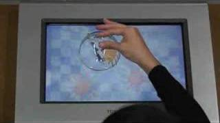 TOSHIBA Interactive 3D Display CEATEC 2006(TOSHIBA releases new interactive 3D display in CEATEC2006. It seems very cool that 3D image interacts real object (transparency cup) in realtime. Website ..., 2006-10-05T23:07:47.000Z)