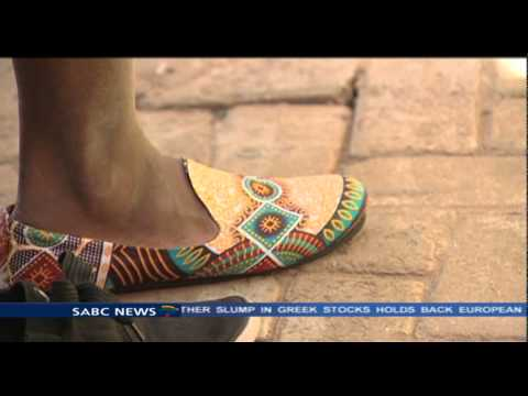 Freddie Gitari makes shoes using African prints and fabrics