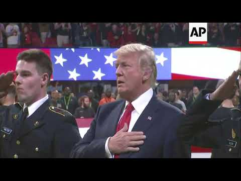 Trump sings national anthem at college football game