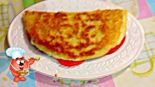 Быстрый завтрак из лаваша с начинкой на сковороде с помидорами сыром ветчиной