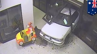 Ram-raid caught on video as jewelry thieves drive car through shopping mall in Canberra, Australia