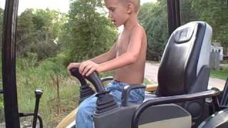 Repeat youtube video 5 & 6 Year Old Operating Cat 303 Excavator and Bobcat