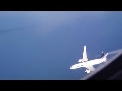 Boeing 777 viewed from another B777 at cruising level over the Atlantic.