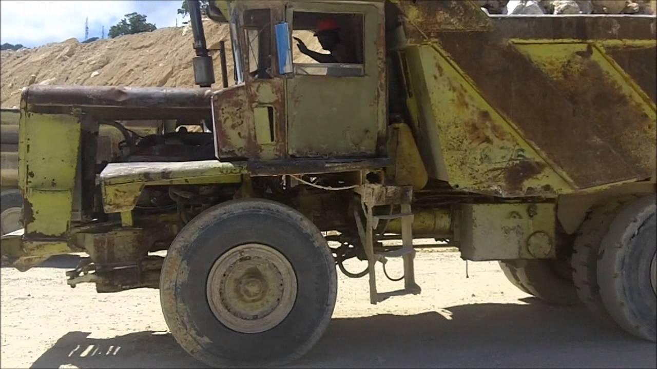 Euclid dump trucks jake braking down hill at quarry youtube