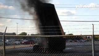 VIDEO: Fire on our #PennState trip? Dump truck bucket hits high voltage line near Detroit airport. P