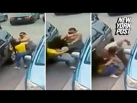 Gigantic goon beats a woman over a 'stolen' parking spot