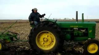 80 John Deere and 4 bottom plow
