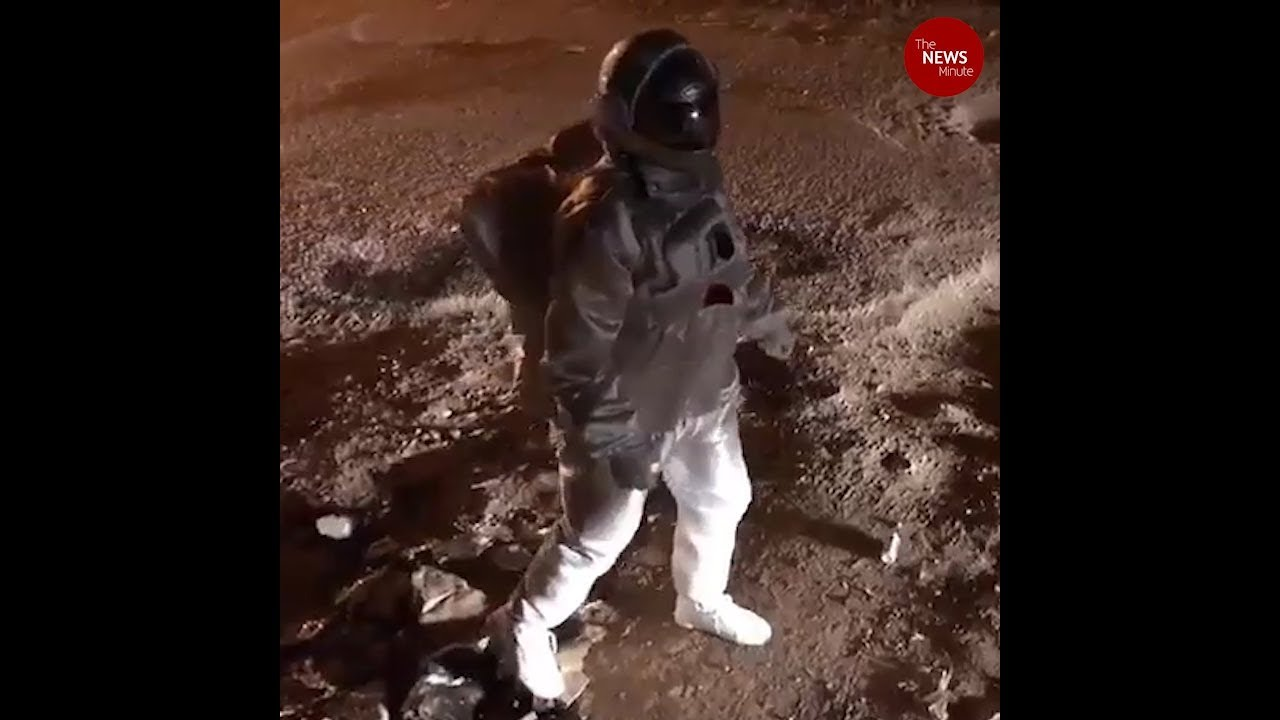 Moonwalk in Bengaluru! Crater-sized potholes turns lunar surface for artist