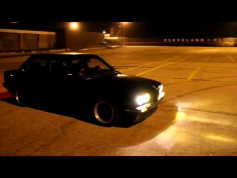 Stanced BMW e30 roasting tires in Cleveland parking lot.