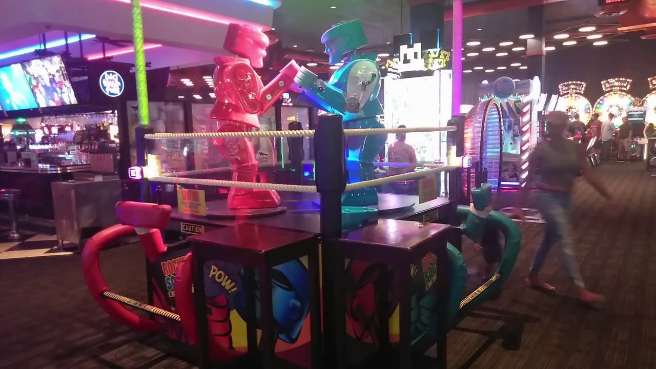 Playing Large Rock 'Em Sock 'Em Robots  At Dave And Busters