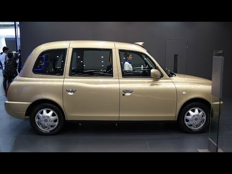London Cab Covered In Golden At Shanghai Auto Show